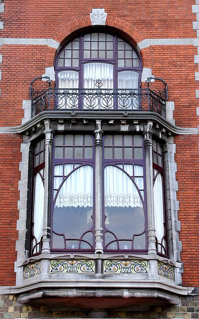 Art nouveau window and balcony...love the romance of this window..