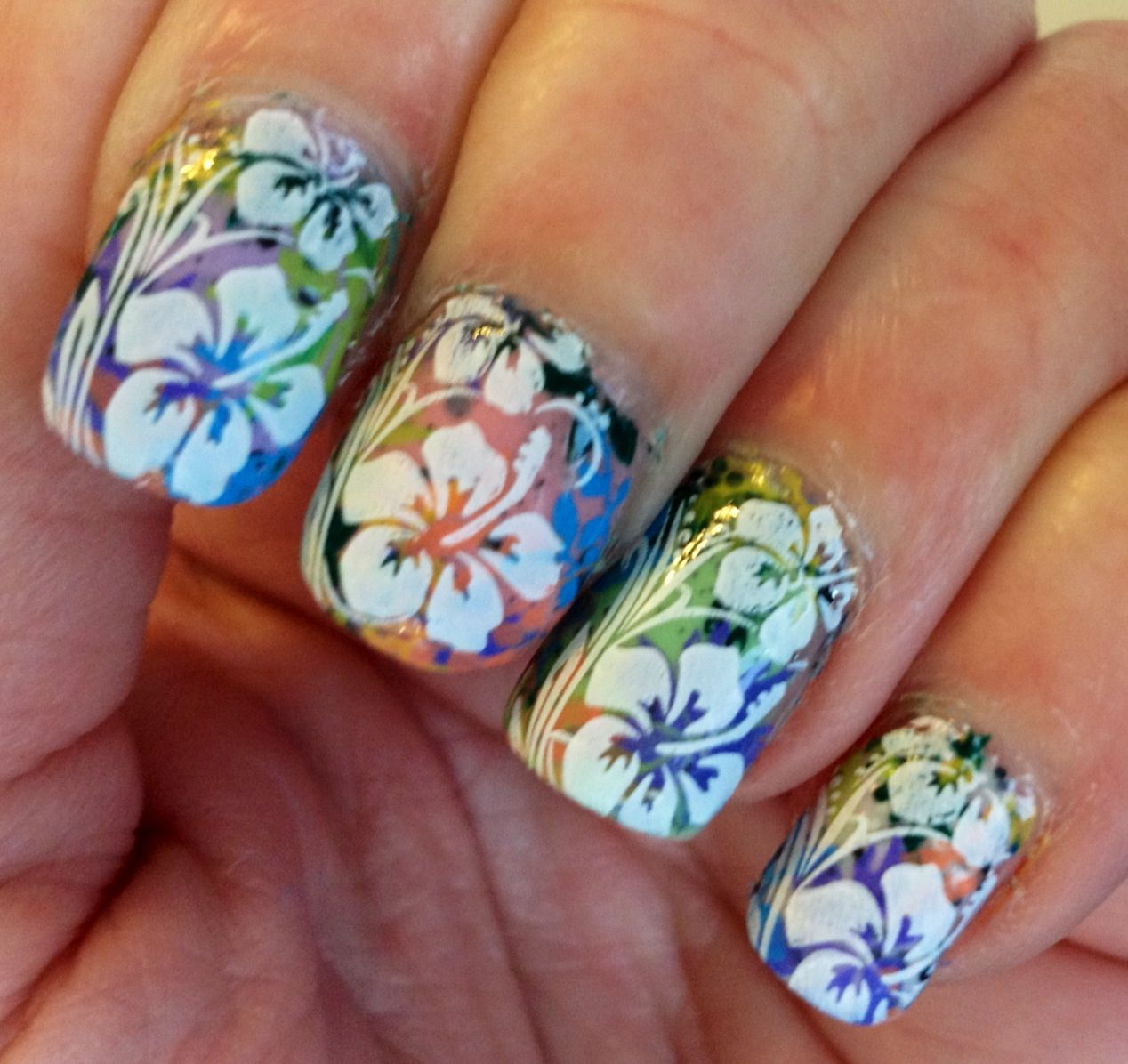 Spring flowers i like the mixed color background nails flowers nail stamping izmirmasajfo