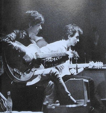 Stu Sutcliffe (left), original bassist for the Beatles, with George Harrison in Hamburg, Germany, where Sutcliffe died of a brain aneurysm in 1962 at age 21. Photo by Astrid Kircherr.