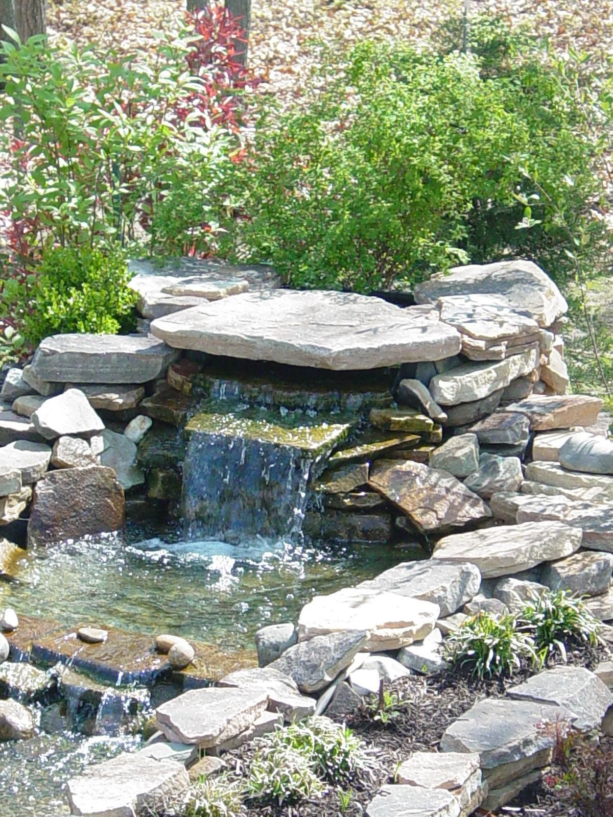 Small pond waterfall with cantilevered rock and hidden for Garden design with pond and waterfall