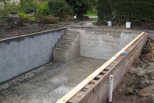 Home built swimming pool swimming pool pool for Concrete swimming pool construction