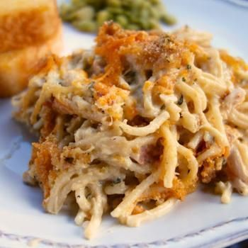 Cheesy Chicken Spaghetti Casserole - I cut this in half and it still filled a 8x11 pan. I used whole wheat pasta, eliminated the butter, used my homemade cream of chicken soup, and used only 1/4 cup breadcrumbs. #casserole #recipes