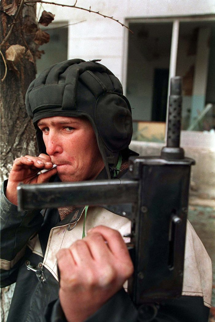 A Chechen fighter holds up his home-made gun during the battle for Grozny, January 1995