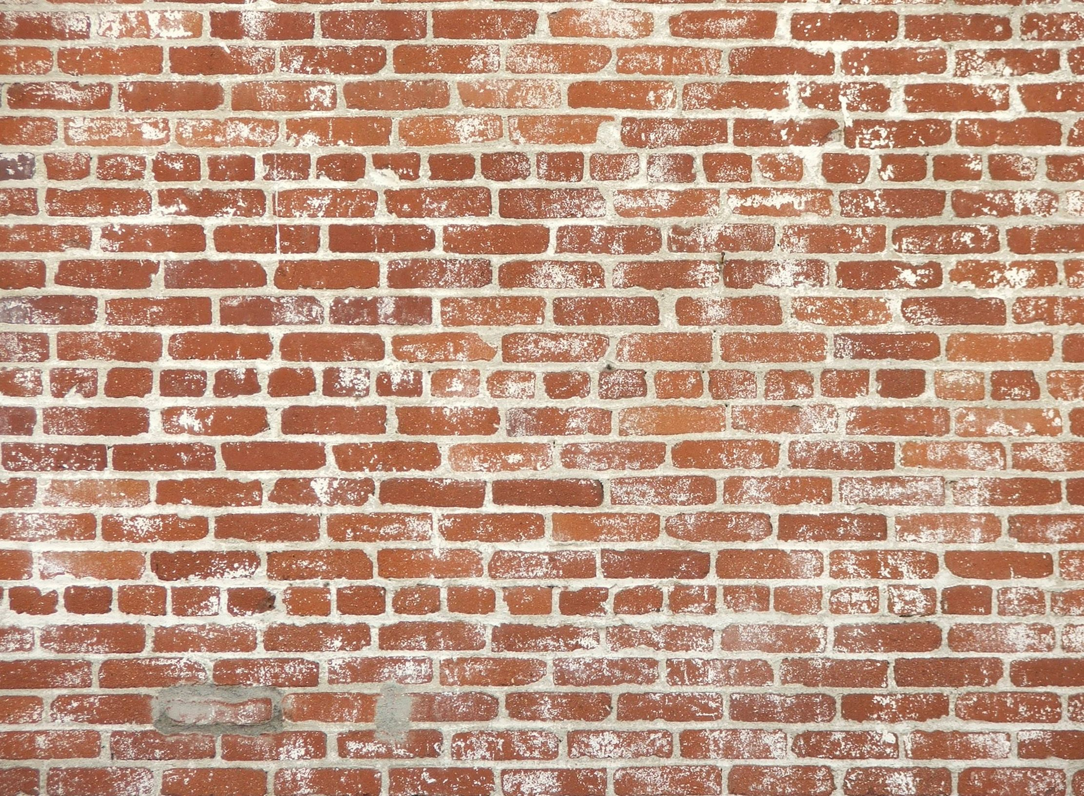 Brick wall background forty three texture and background for Wallpaper on house walls