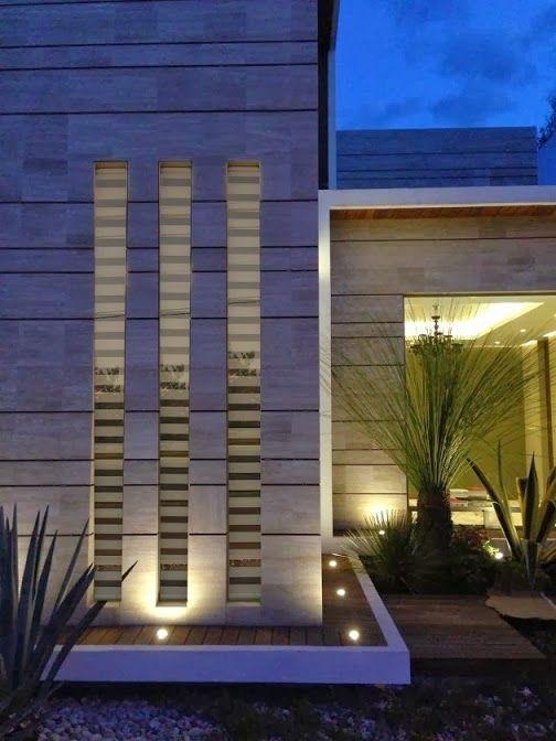 Fachada moderna con marmol navona ji studio m xico for Fachadas de casas modernas entre medianeras