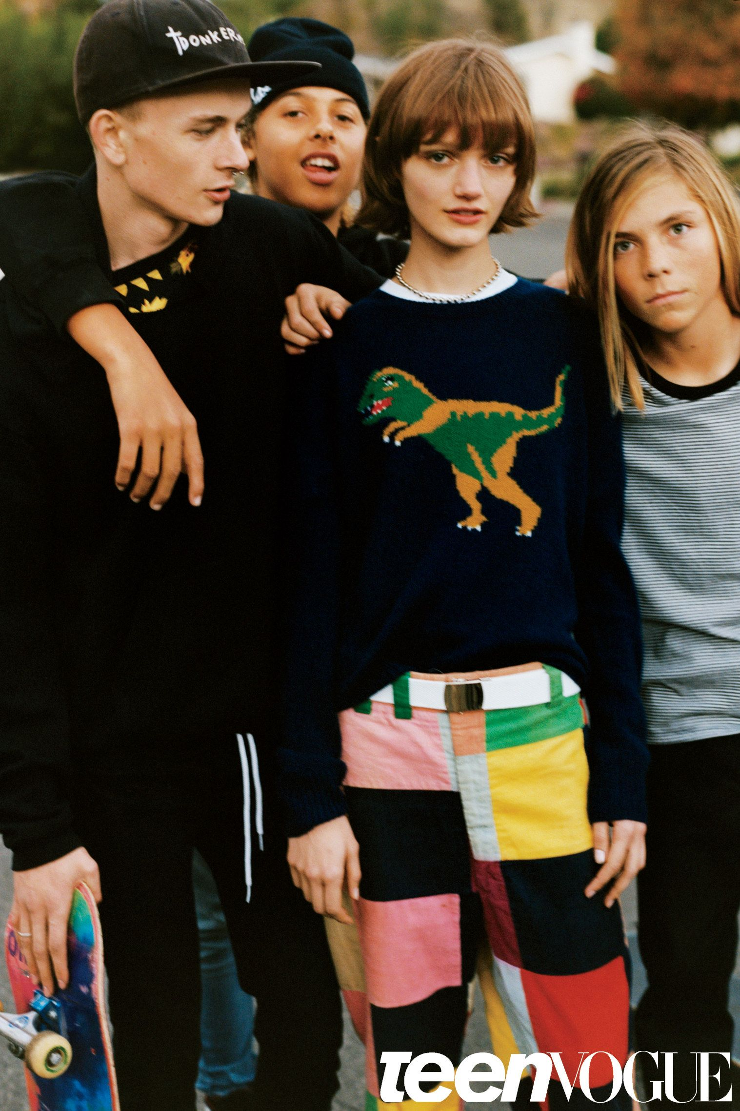 Graphic sweater, color-block pants, and a cute bob haircut
