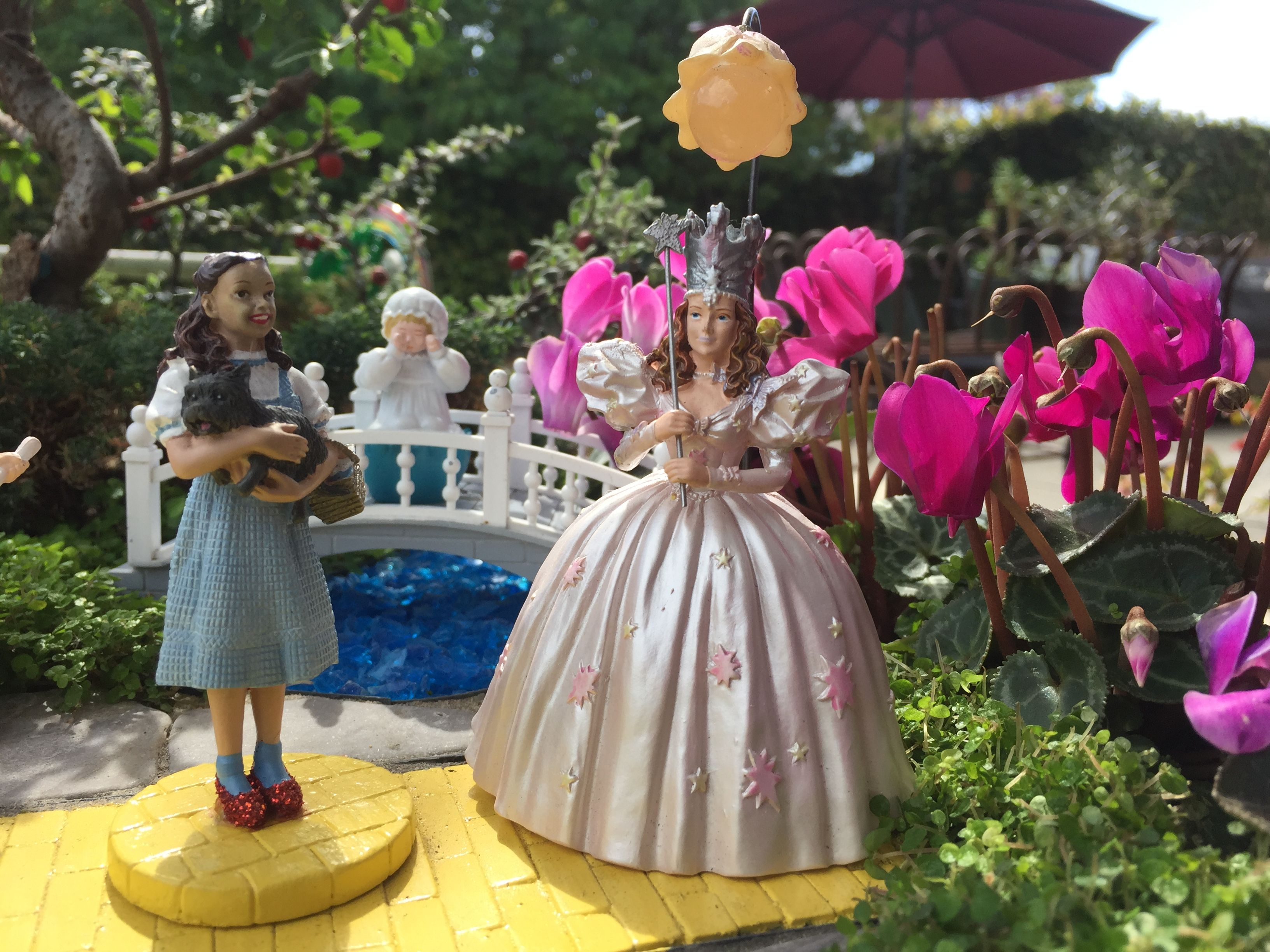 Image result for munchkins wizard of oz flowers scene