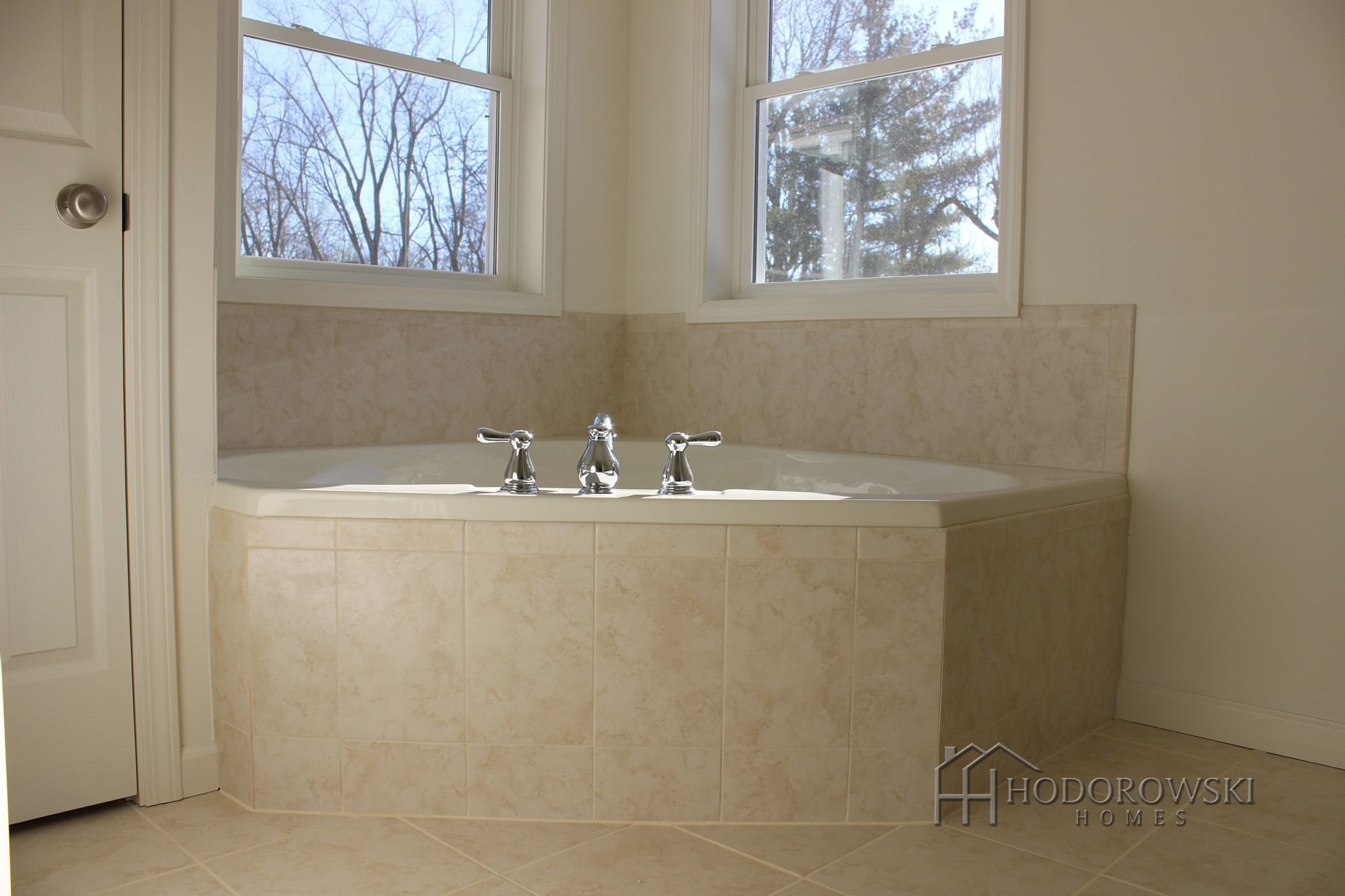 This serene corner garden tub is the City Collection in Cream ...