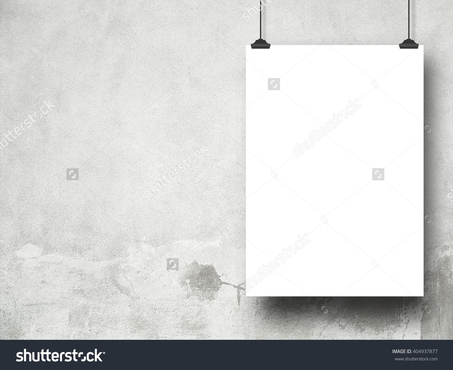 Close-up of one blank frame hanged by clips against grey weathered wall background