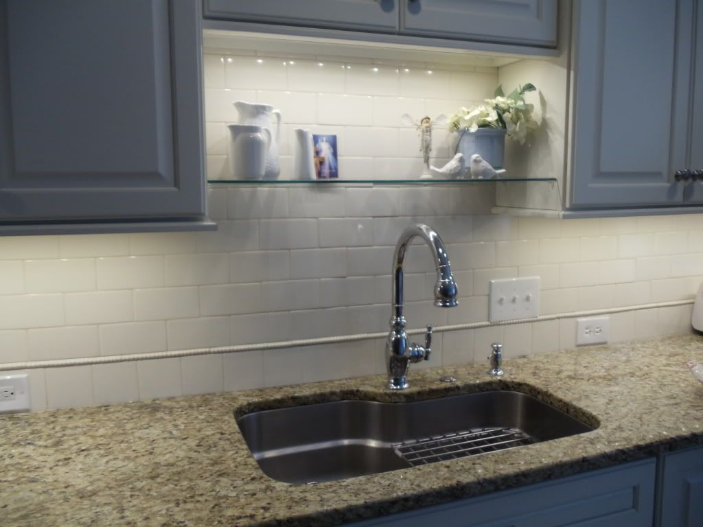 an idea for over sink shelf that won't interfere with new lighting