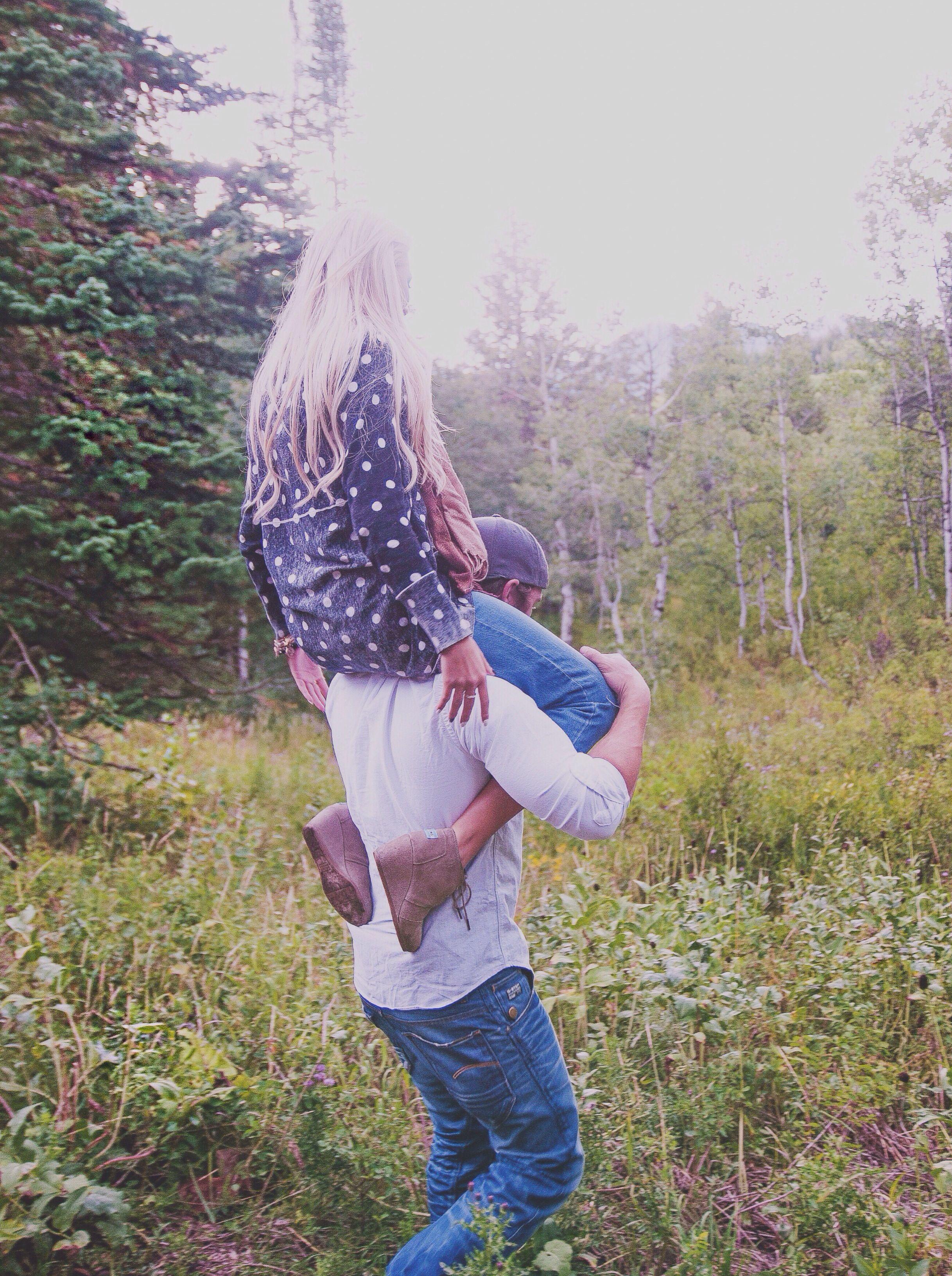 Couple. Shoulder rides. Mountains.