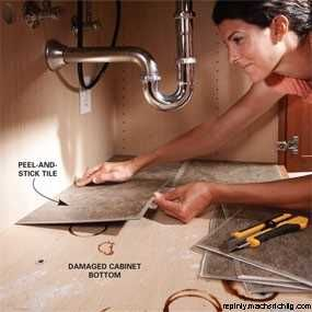 Peel and stick tiles under the sink. Easy to clean and protects the base of the cabinet from water and chemicals.