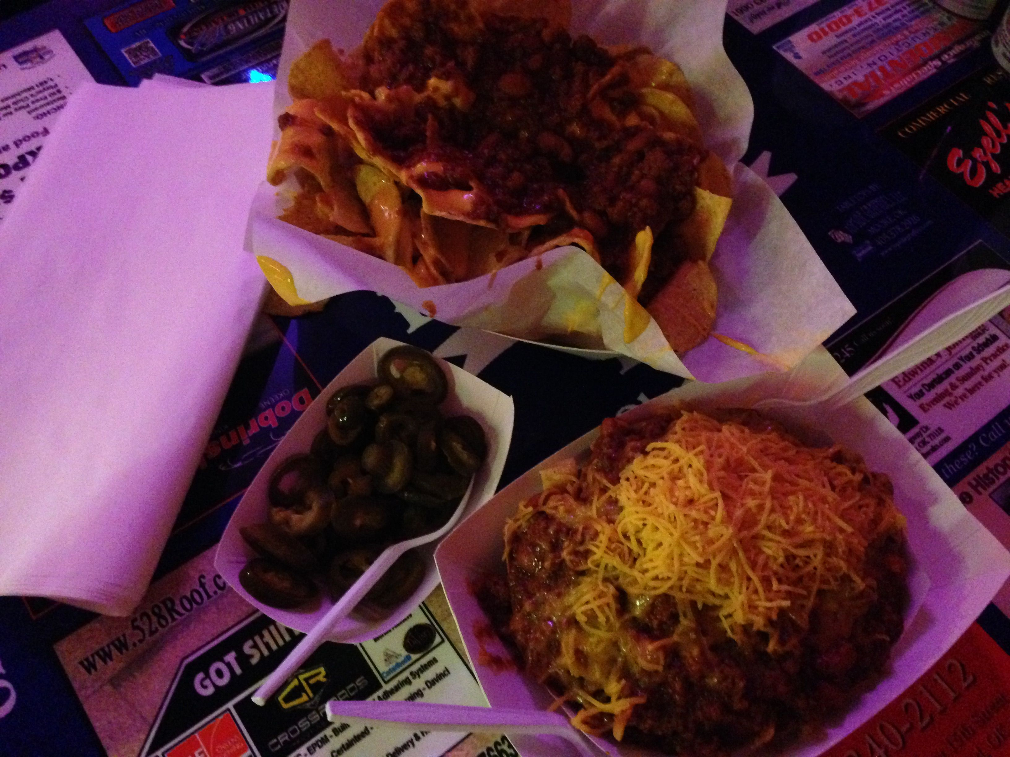 Chili Cheese Nacho's and Frito Pie with a side of jalapeno peppers.