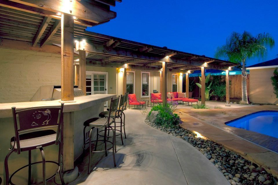 Poolside Patio Outdoor Kitchen And Arbor By West Bay Landscape Co San Jose Poolside Patio Outdoor Kitch In 2020 Outdoor Outdoor Living Diy Outdoor Kitchen