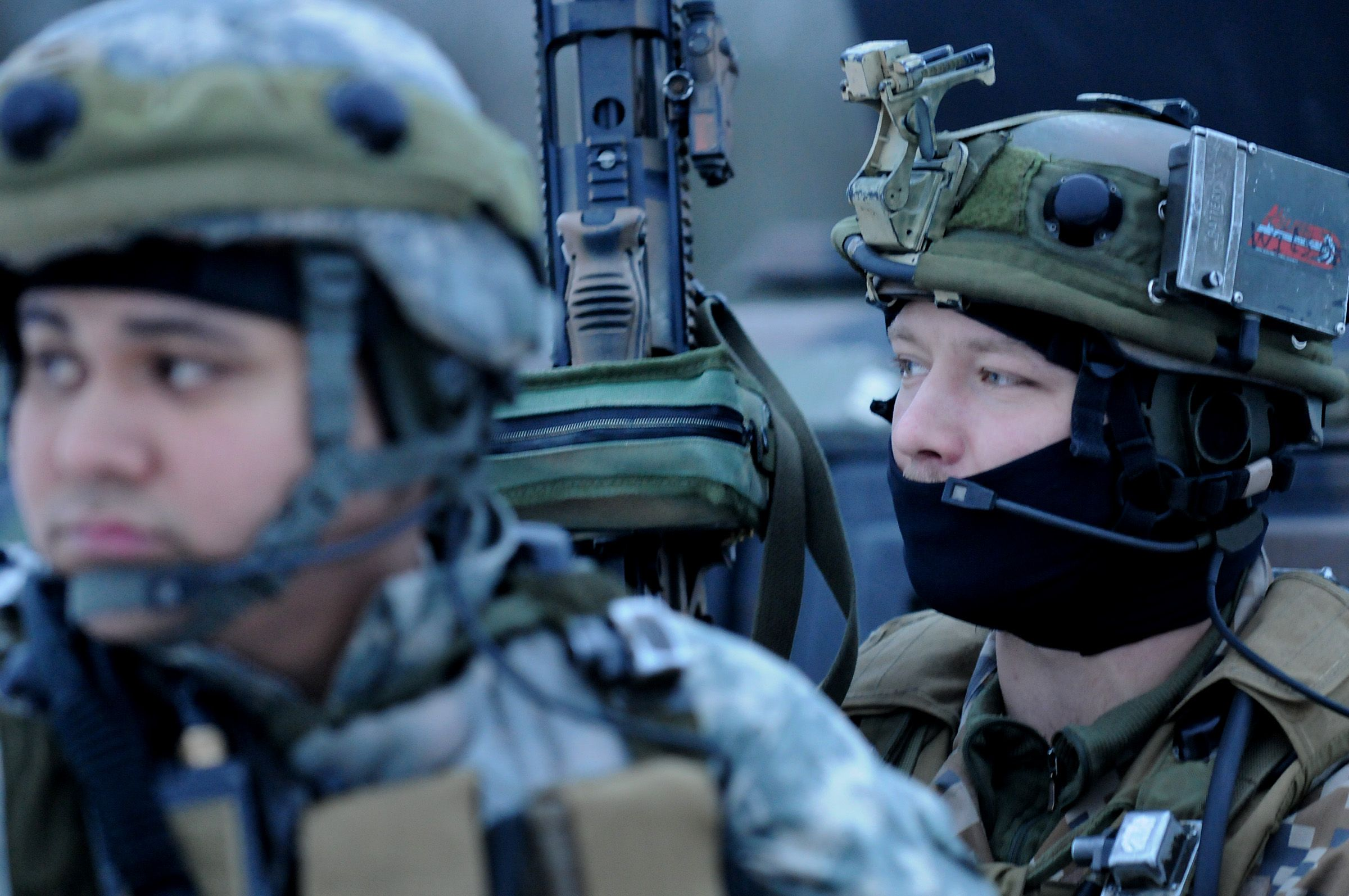 A Soldier in the Michigan National works alongside a Latvian Soldier during a simulated-combat exercise at the Joint Multinational Readiness Center in Germany.