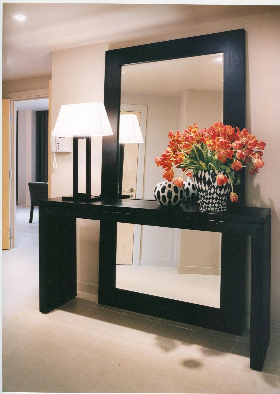 Full length mirror behind console table new york ny interior design by jo laurie design photo credit jo laurie design