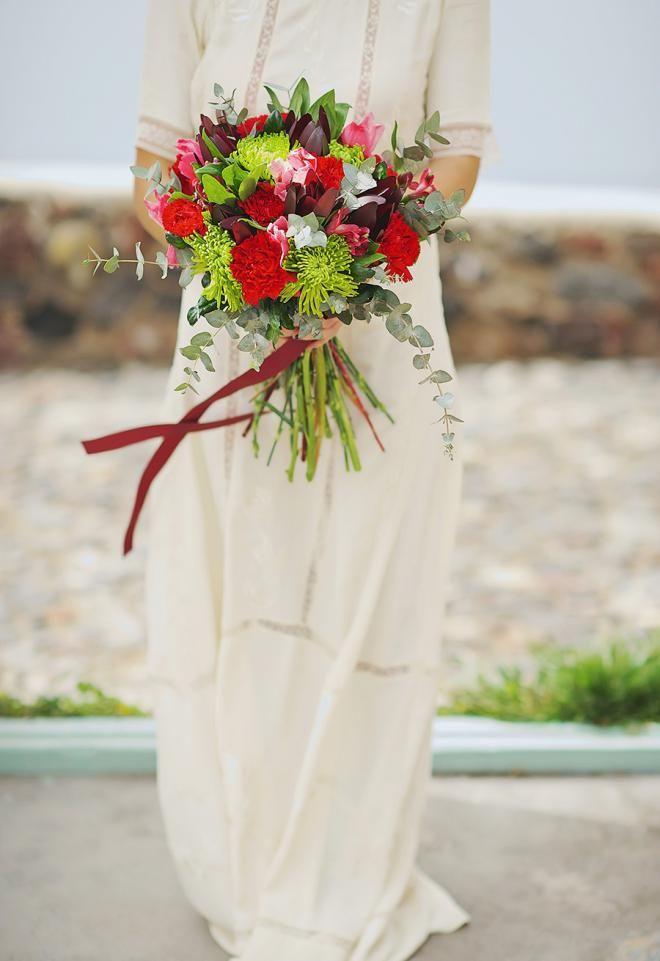 Boho wedding in Santorini- wedding bouquet in red and marsala