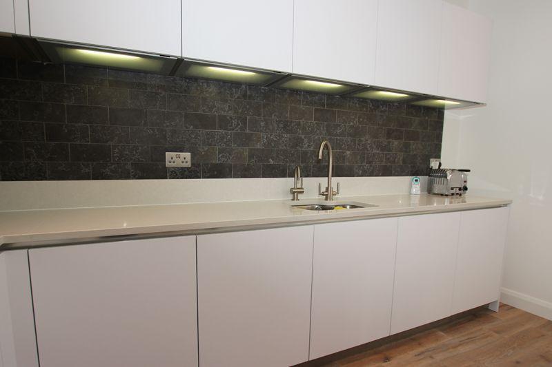 White Matt Laminate Kitchen Cabinets With Under Cabinet Lighting
