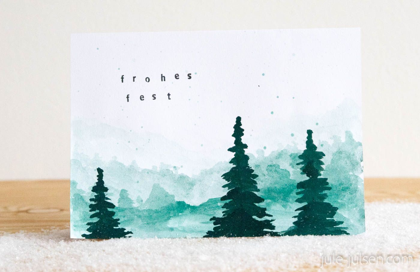 Photo of DIY Christmas card, watercolor winter landscape