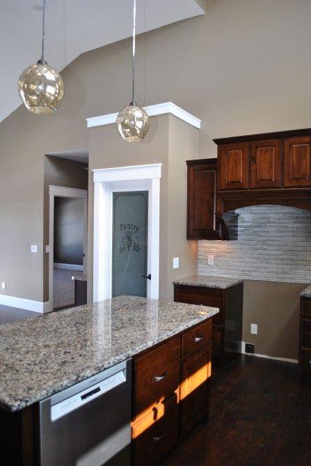dark brown kitchen cabinets granite counter tops white trim beige paint pantry door with. Black Bedroom Furniture Sets. Home Design Ideas