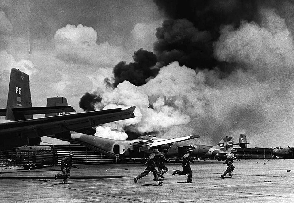 North Vietnamese soldiers run past destroyed aircraft on the tarmac of Saigon's Tan Son Nhat airport after the advancing Communist forces shelled the airport. Description from navy.memorieshop.com. I searched for this on bing.com/images