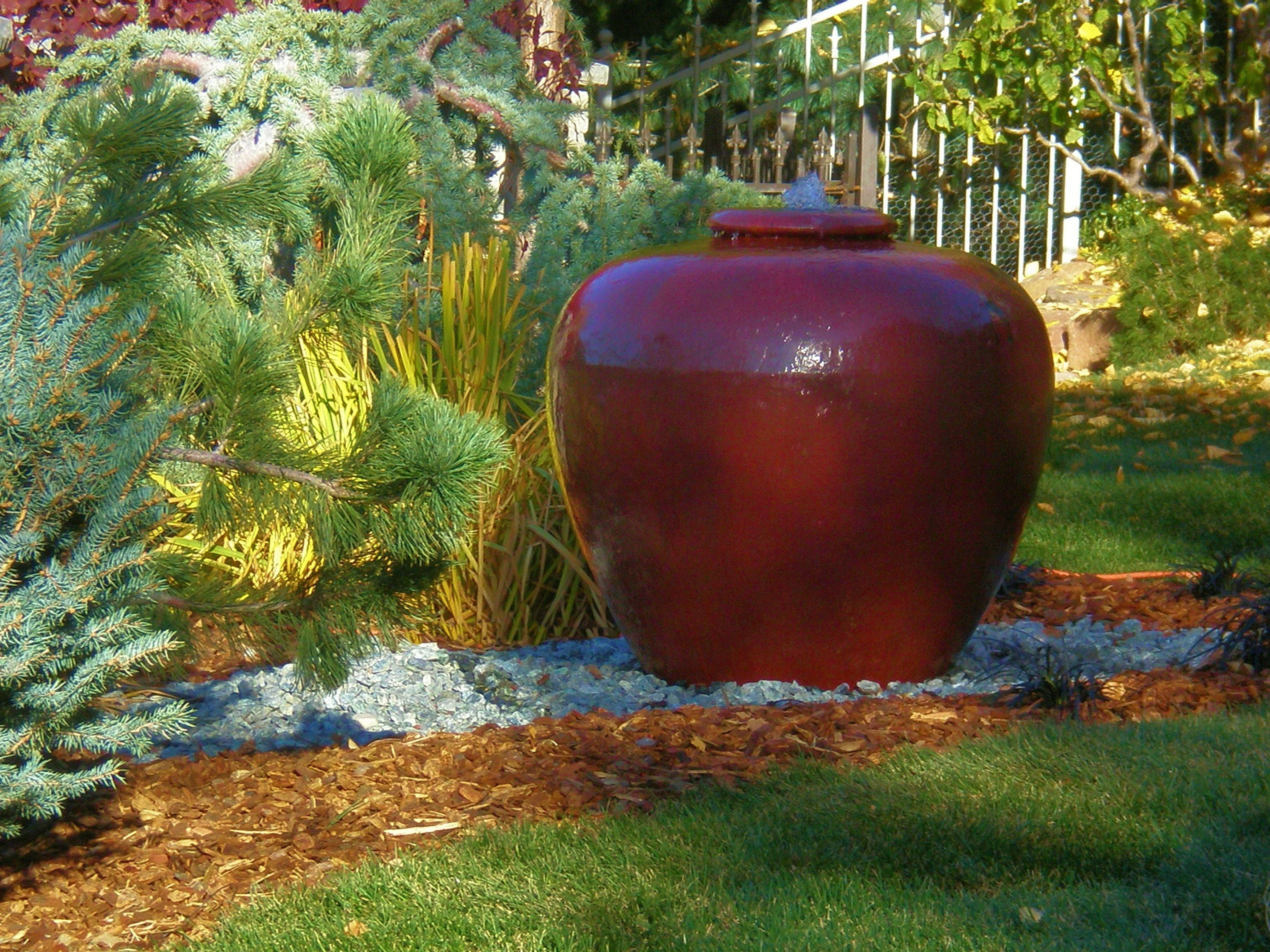 Water Feature Made Out Of An Oversized Ceramic Pot With A