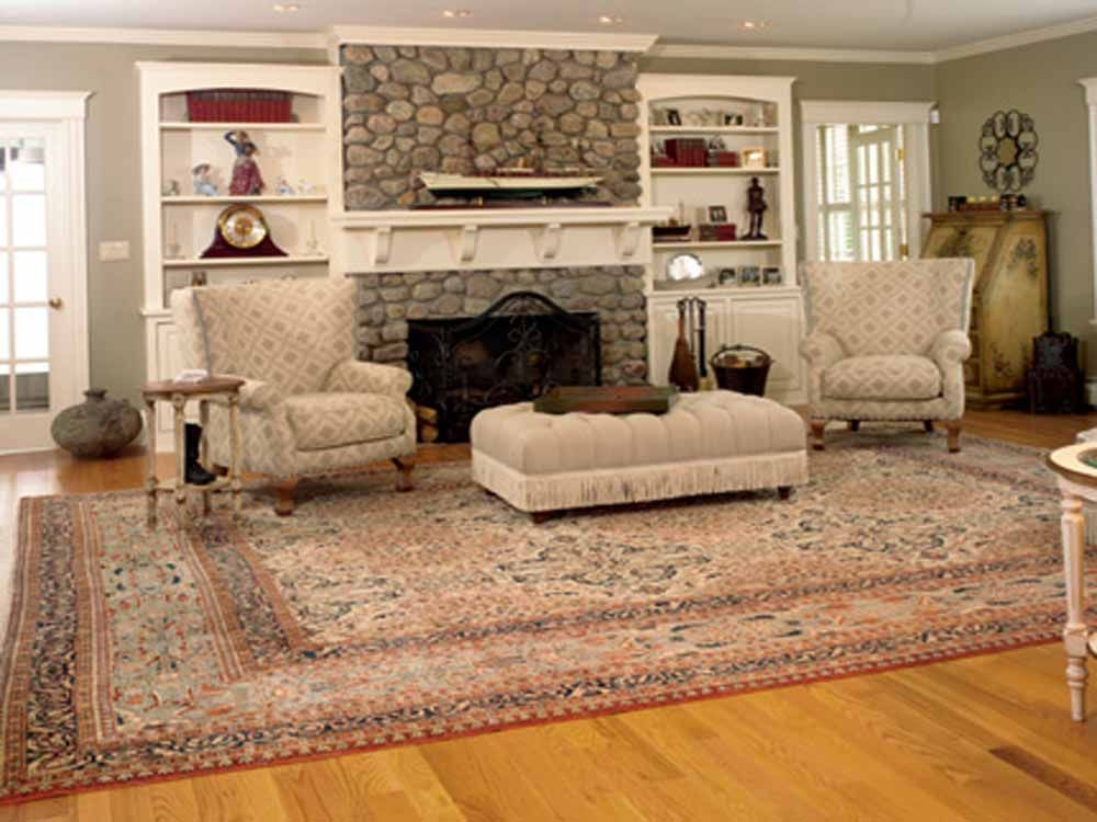 Unique Ways Of Using Your Huge Rug With Images Big Living Room Rugs Gray Rug Living Room Living Room Area Rugs