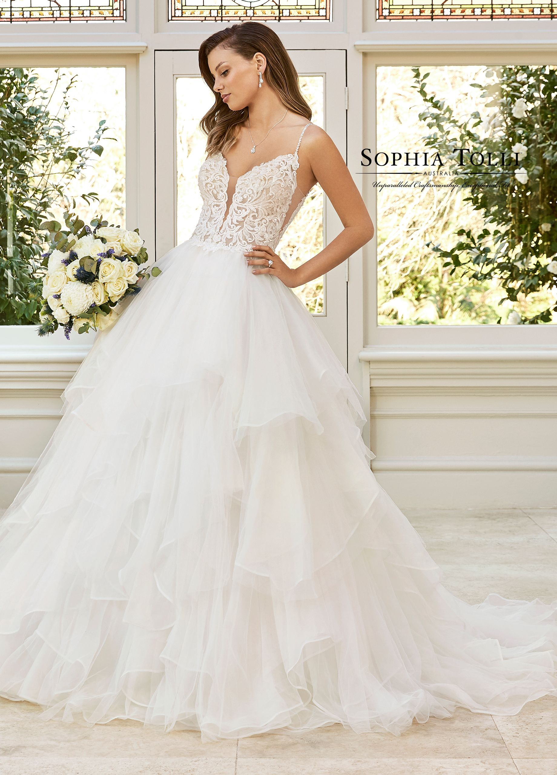 9ff09495be3 ... Style Y11952- Introducing Remi – an unforgettable ball gown that is  pure heaven. Misty tulle tiered skirt ruffles over organza. Deep-V neckline  with ...