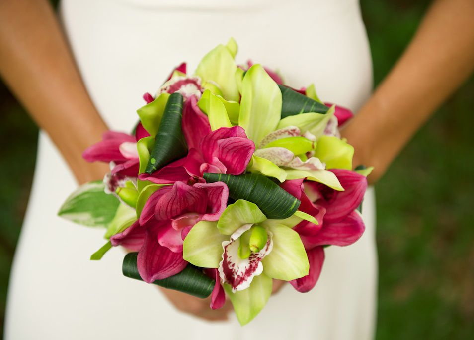 Tropical Wedding Bouquet Dream! Green and Fuchsia Natural Touch Silk Cymbidium Orchids with tropical looped leaves. From www.wedideas.com