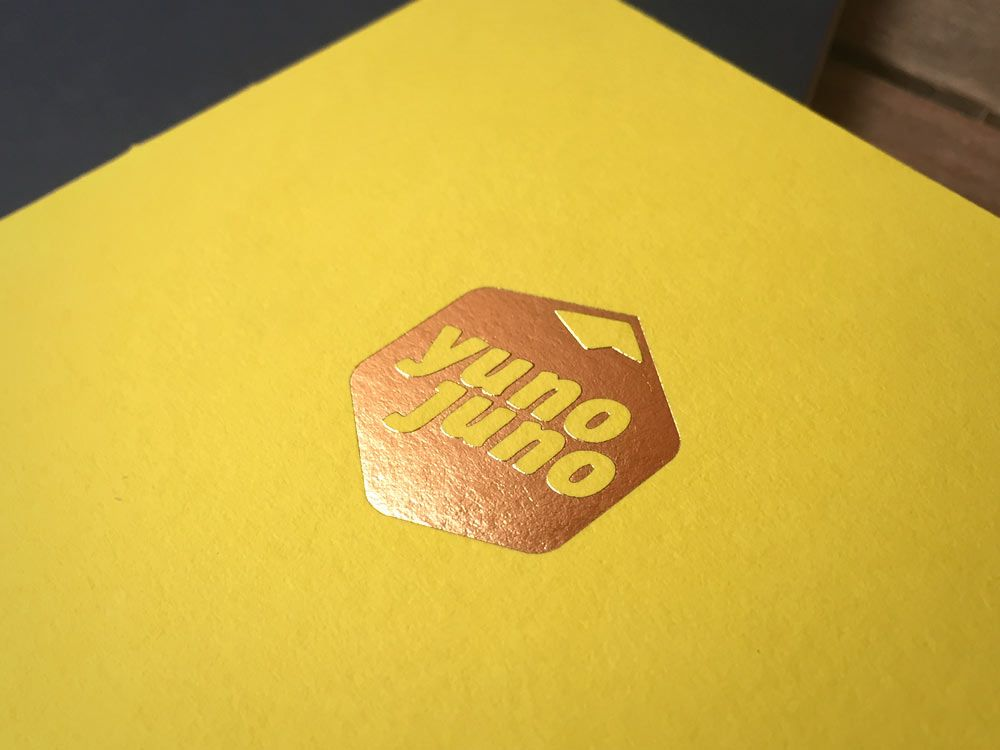 Gold hot foiling for Yuno Juno on GFSmith Colourplan factory yellow custom journal. Talk to us today about how we can create a bespoke, branded, custom card item for you.