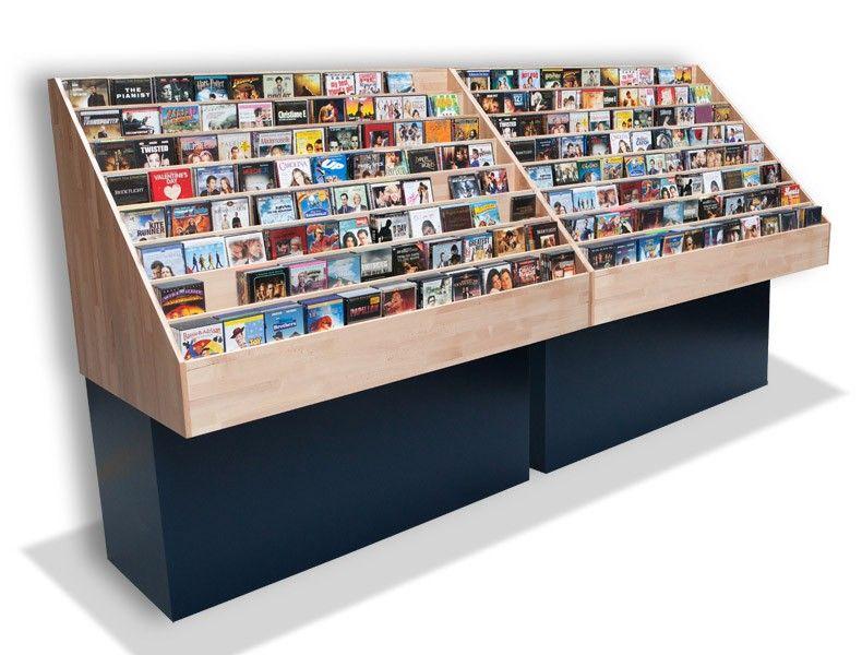 DVD-wand voor winkel Deze wandmeubels zijn zo ontworpen dat alle voorste covers zo goed mogelijk zichtbaar zijn. CD's of DVD's worden geplaatst in stapeltjes van 5, waardoor de kast ook zeer geschikt is voor verzamelboxen. Door de relatief kleine stapeltjes zijn relatief veel covers zichtbaar, wat zorgt voor een aantrekkelijke presentatie.  Het bovendeel is van massief (gelakt) beukenhout, dus zeer degelijk en slijtvast.