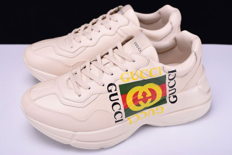 c9c681ad912 Gucci Logo Rhyton Vintage Trainer Sneakers with thick sole and a steady  structure design
