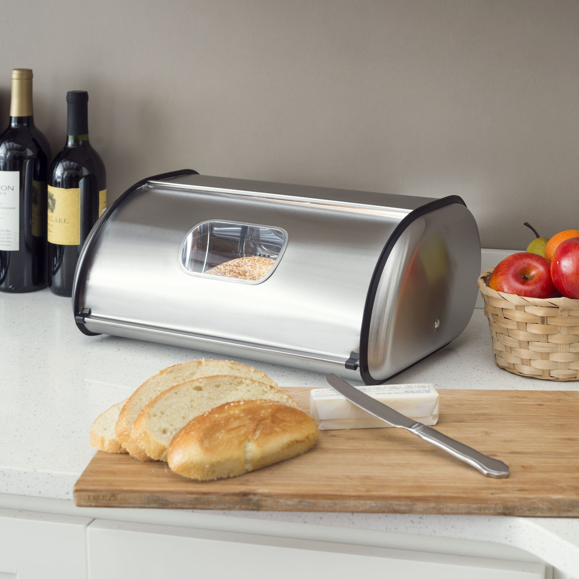 From rich, moist chocolate chip cookies to soft, herb infused bread, keep all your favorite baked confections neatly stored away and all the aromotic flavors preserved with this modern style breadbox. It boasts a beautiful stainless steel finish with a beautiful jet black trim for eye-catching contrast. A small circular window lets you easily get a sneak peek of what's inside, while the smooth roll-up lid makes it easy for you to grab your favorite treat when needed. Display it on your counterto