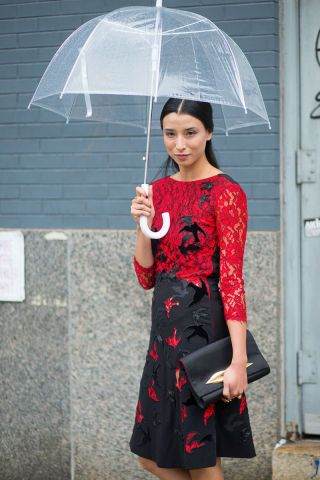 Clear umbrellas are handy when you don't want to distract from an already-stunning ensemble. See all the best NYFW street style here: