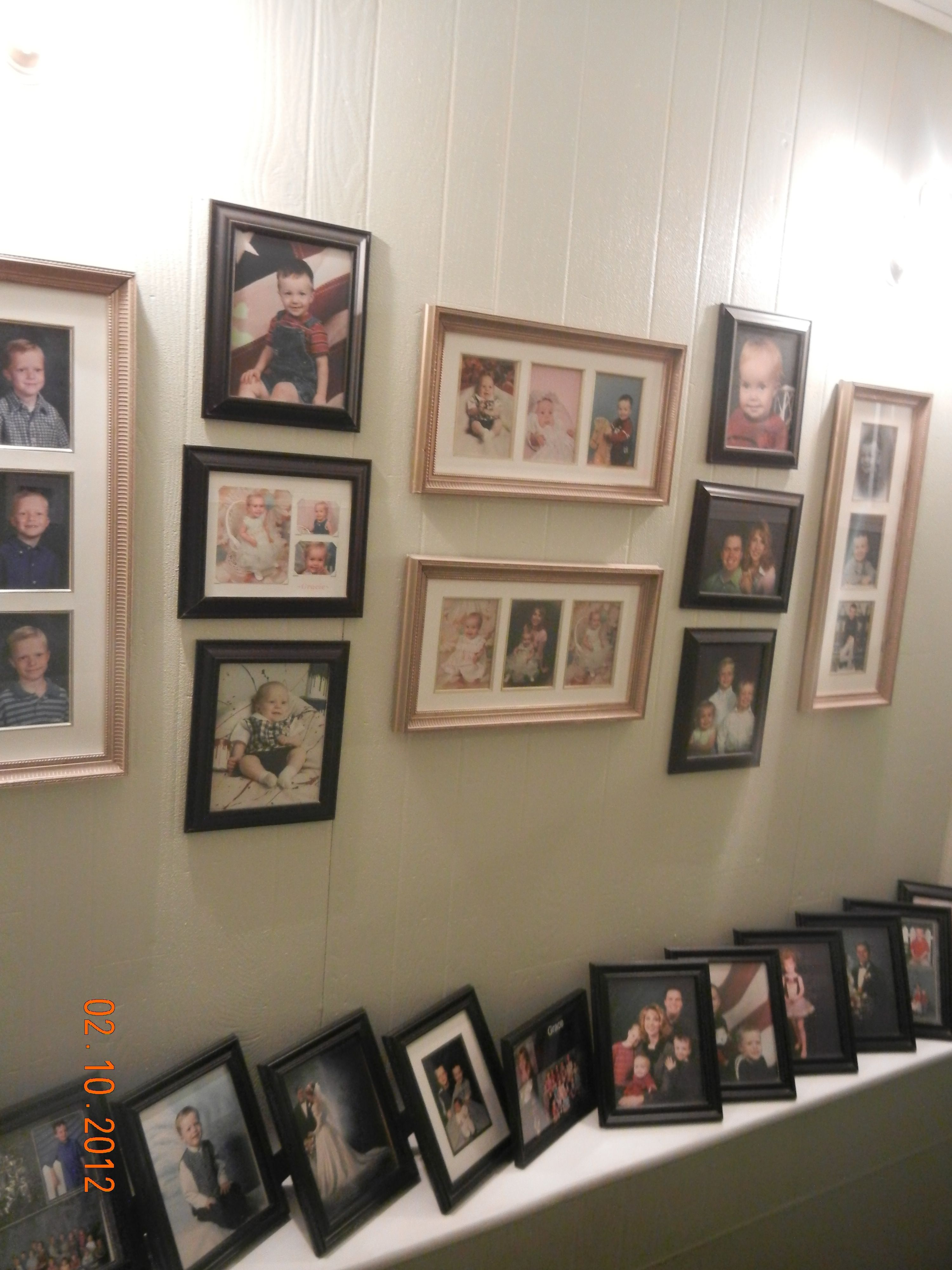 Wal-Mart black picture frames mixed with antique gold collage frames ...