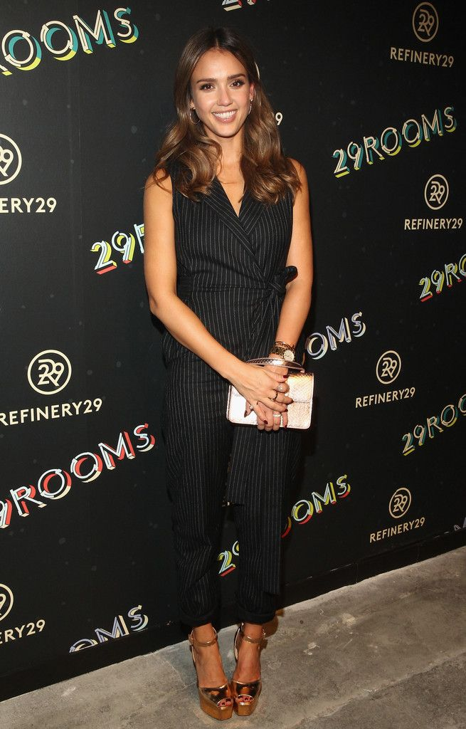 69dcc80c0 Jessica Alba Jumpsuit - Jessica Alba was business-chic in a black  pinstriped jumpsuit while attending the 29Rooms event.