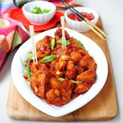 Crispy cauliflower florets in a spicy soy chilli sauce with garlic and onions