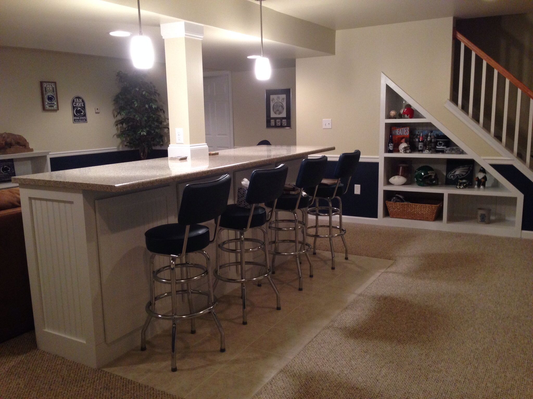 bar built around center support pole in basement  basement ideas . bar built around center support pole in basement