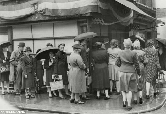Bread omelette and fish made of rice the ingenious and rationing shoppers queue to buy food in london during world war ii forumfinder Gallery
