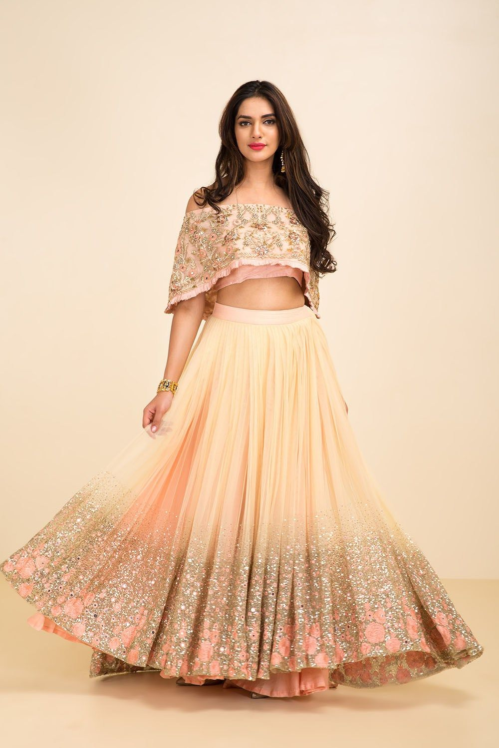 c3a27f7ad622 You don t need a big wallet to look a million bucks. This gorgeous nude  shimmer sequins cape style lehenga is super budget friendly.  Frugal2Fab