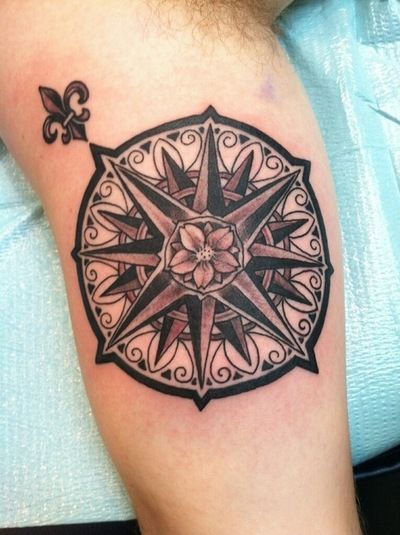 A beautiful compass rose courtesy of Jason Johnson of Tattoo Faction in Cleveland, Ohio