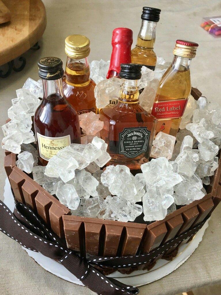 hubby's 40th birthday cake- kitkat, white rock candy and mini liquor ...