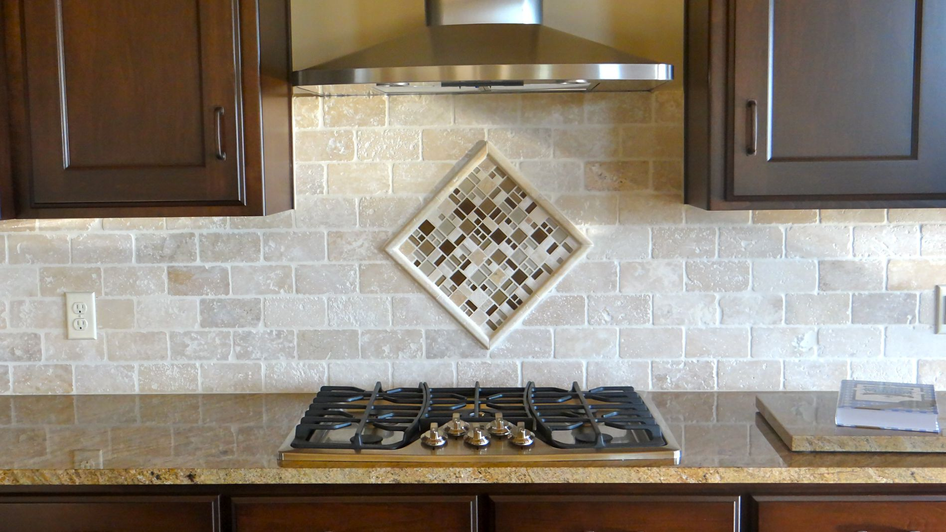 Tumbled travertine subway tiles accented with a single 12x12 mosaic tumbled travertine subway tiles accented with a single 12x12 mosaic sheet set on point and framed dailygadgetfo Gallery