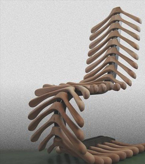 Spine looking chair that is actually made from wooden coat hangers.