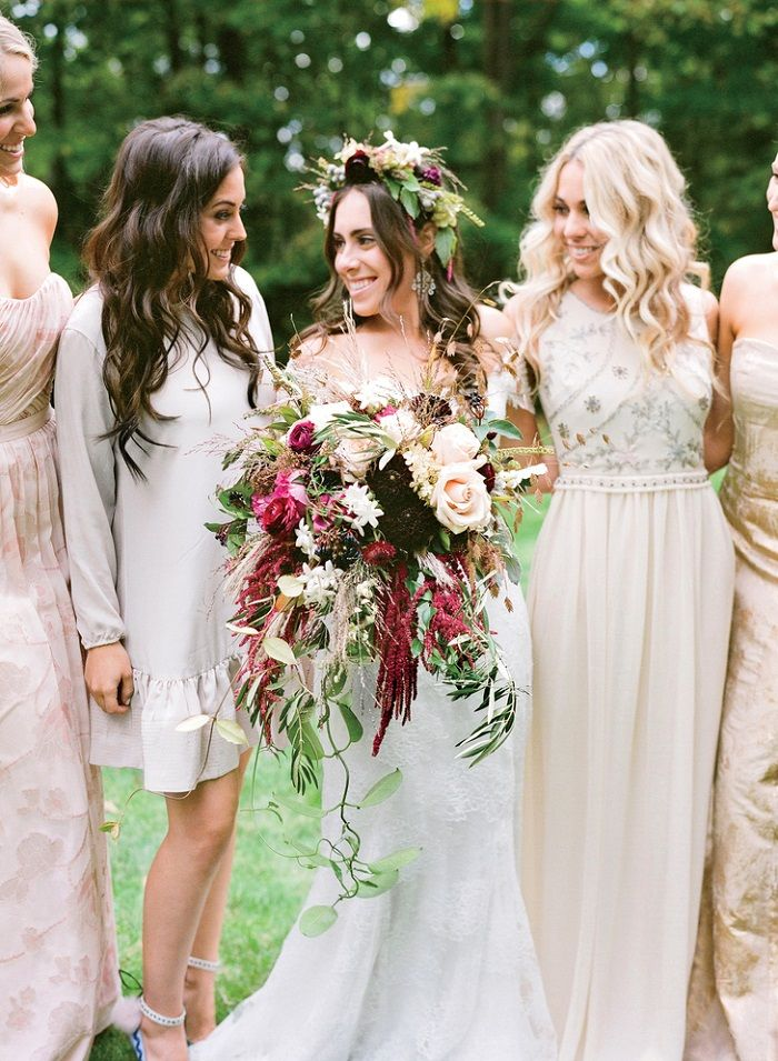 Gorgeous Bride with her burgundy bouquet and neutral bridesmaid dresses #burgundy #fallwedding #wedding #weddingbouquet #bridesmaiddresses