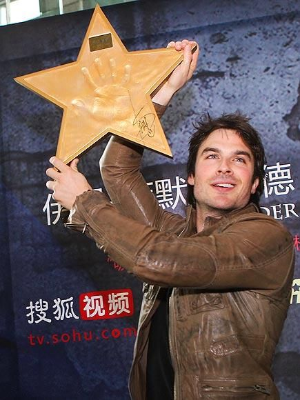 He's a star! The Vampire Diaries hunk Ian Somerhalder shows off his flashy handprint during an appearance at Beijing's Sohu.com headquarters in China. http://www.people.com/people/gallery/0,,20694853,00.html#21315259