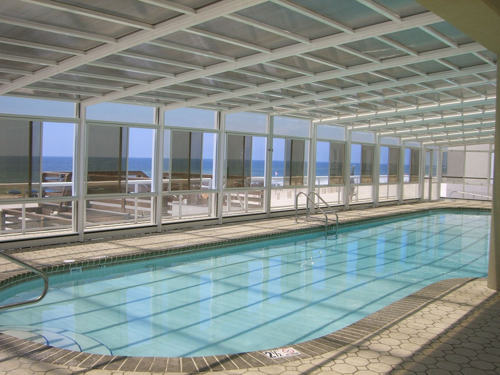 Benefits Of Retractable Pool Enclosures Manufactured By Roll A Cover Indoor Outdoor Pool Pool Enclosures Outdoor Pool