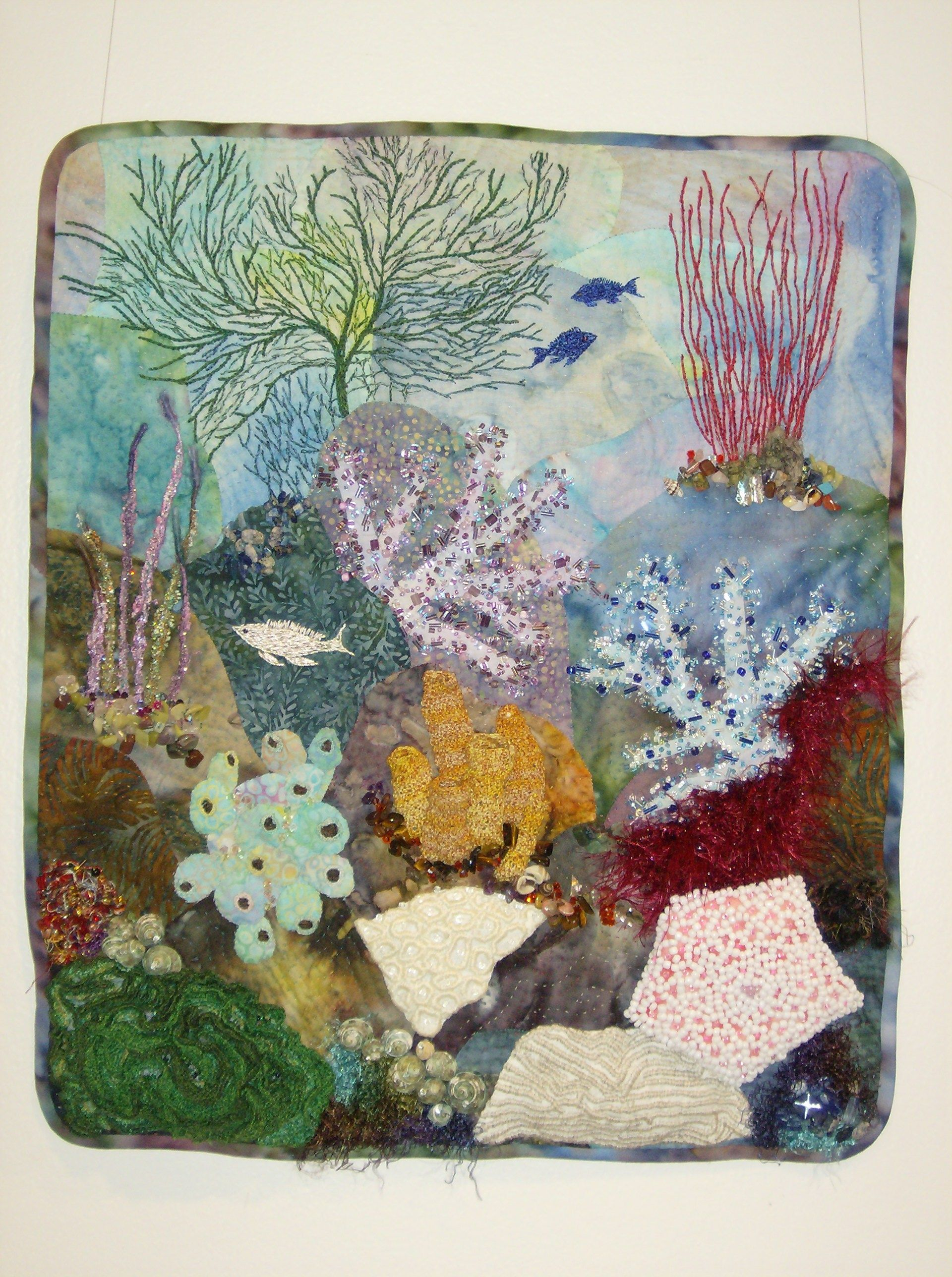 """""""Sous la mer"""" by fibre artist Judith Veinot. Thousands of tiny stitches are used to build up the layers of this very complex piece."""