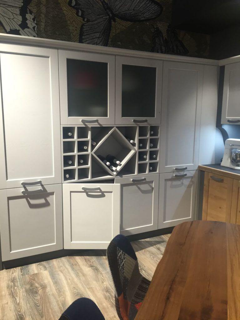 Light gray kitchen cabinet with wine storage kitchen in