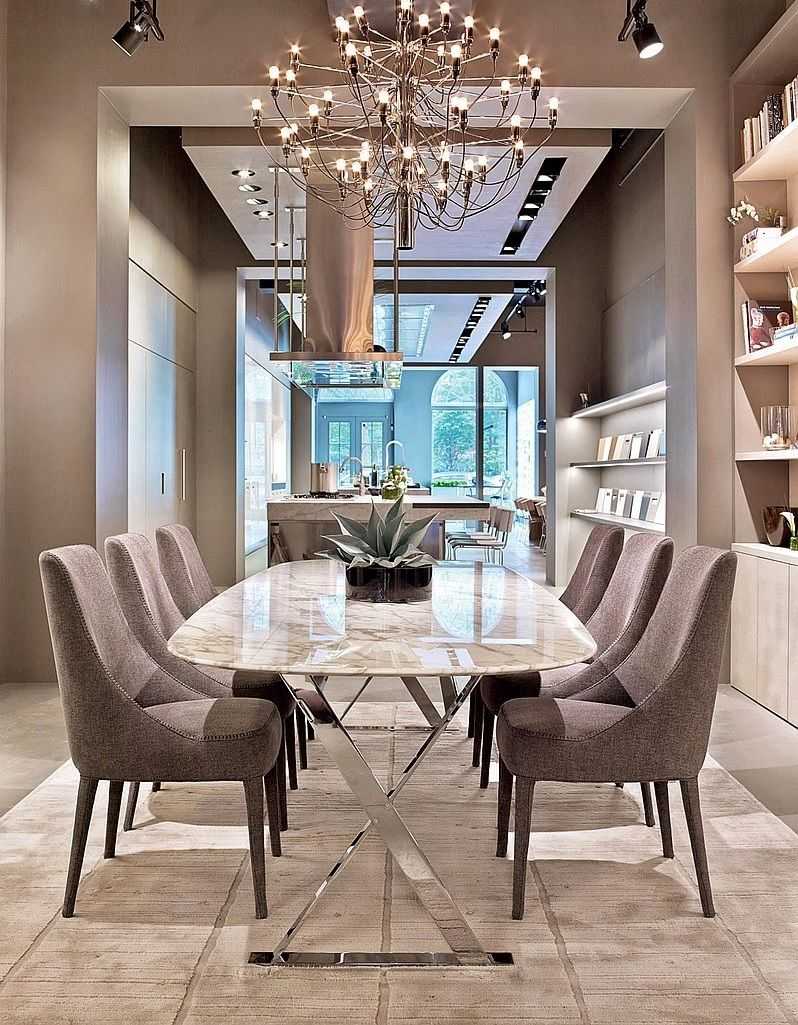 Superb Gino Sarfatti Designed The Chandelier In A Dining Area. Photography By Eric  Laignel.